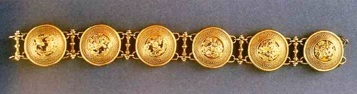 A gold bracelet. 1860. Each link of the bracelet in the form of a typical Castellani motif, which he used in brooches