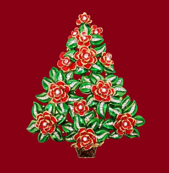 A large Christmas tree brooch by Cristobal London. Gold plated metal, green enamel, clear and red crystals