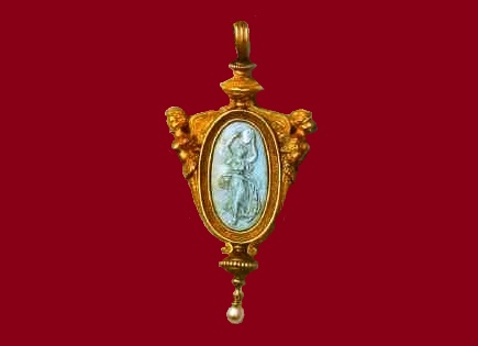 A pendant made of gold with pearls, in the center - a cameo of turquoise with the image of Terpsichore, the muse of dances, on the reverse the signature of two interlaced 'C'. 1860