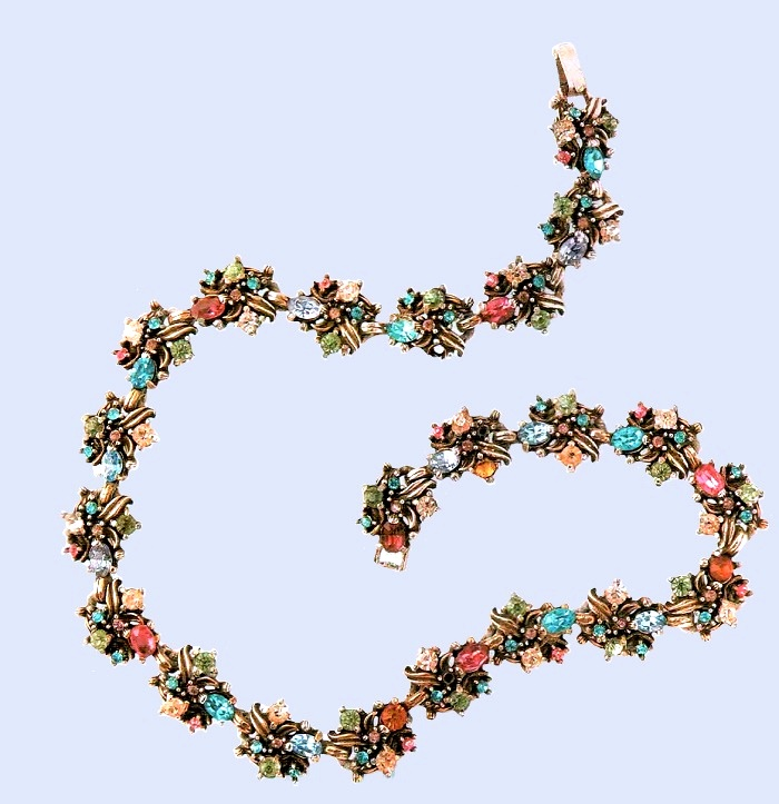 A rare necklace. Metal, gilding, rock crystal of turquoise color, aquamarine, pink, orange and transparent. 1950's. circumference 37 cm. £ 95-105 MG