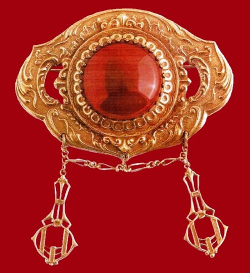 Art nouveau style brooch. Antique metal of gold tone, a cabochon of artificial carnelian. 1960's. 7.5 cm £ 40-45 ABIJ