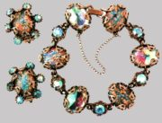 Bracelet and earrings. Metal, gilding, blue aurora borealis and glass cabochons (foil). 1950's. The bracelet 20.25 cm, earrings 3.75 cm. £ 160-175 MG