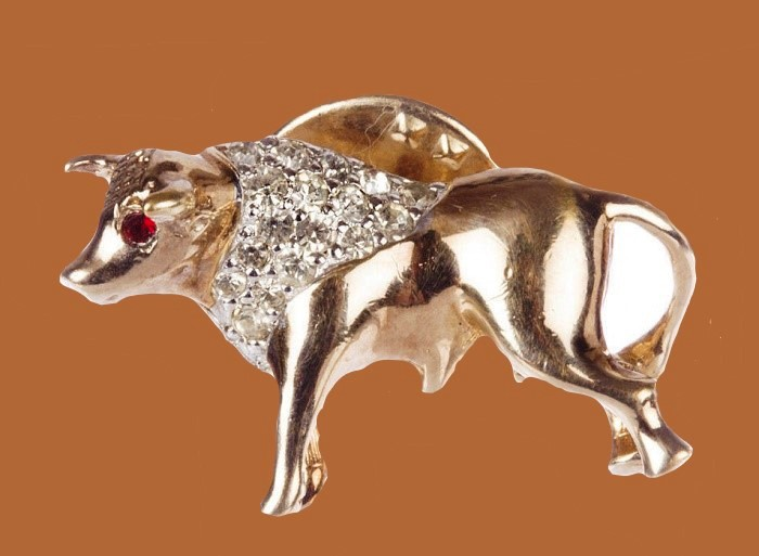 Bull pin with clear rhinestones on the bull's neck and red rhinestone eyes. 1960s