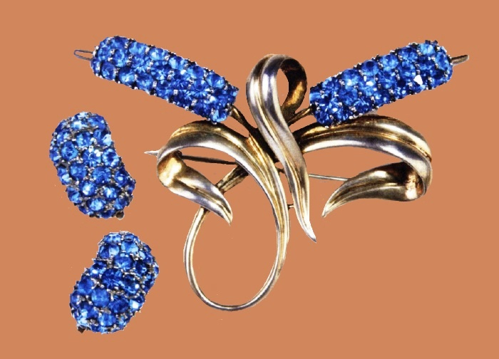 Bulrush Set, 1947. Gold-plated sterling brooch and earrings with blue faceted stone pave. Designer Oreste Pennino. Brooch 7.5x9.6cm; clip earrings 2.5cm