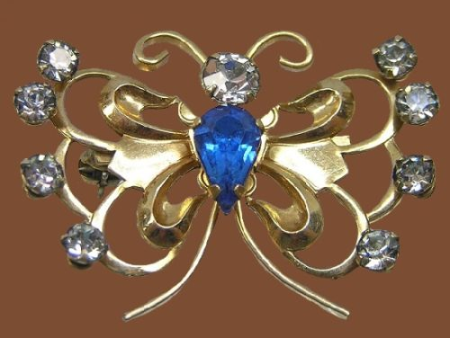 Butterfly brooch pin. 12-carat gold, blue and transparent crystals, vintage