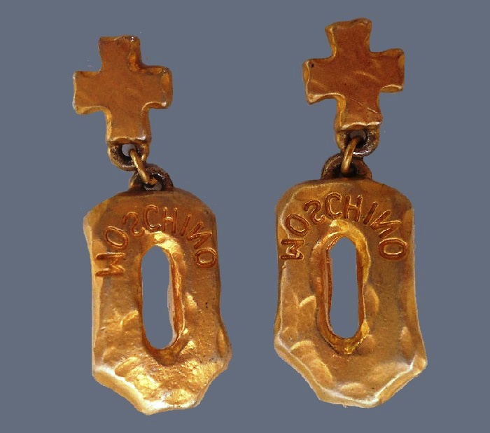 Cross earrings of goldtone metal, signed Moschino