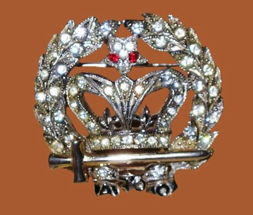 Crown with sword brooch. Rhodium plated, rhinestones. 1940s