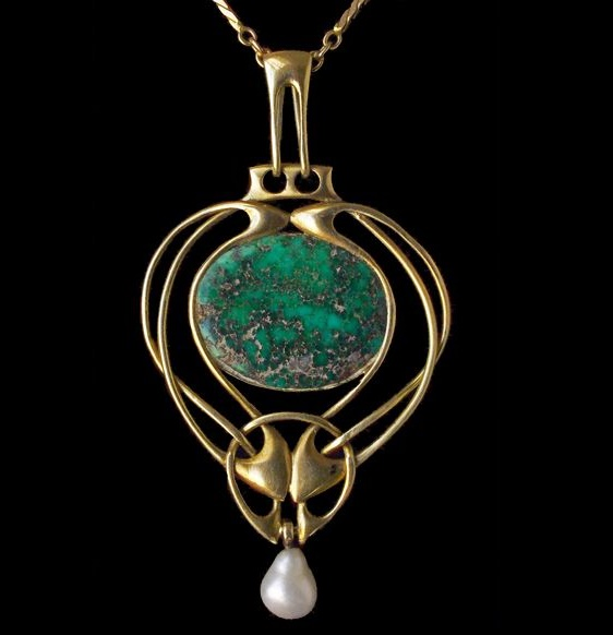 Elegant pendant created by Archibald Knox