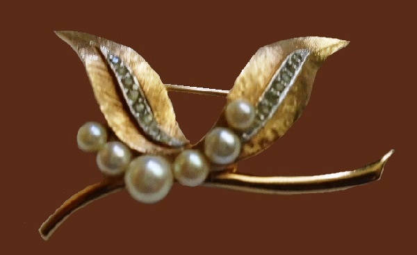 Faux pearls and clear rhinestone brooch
