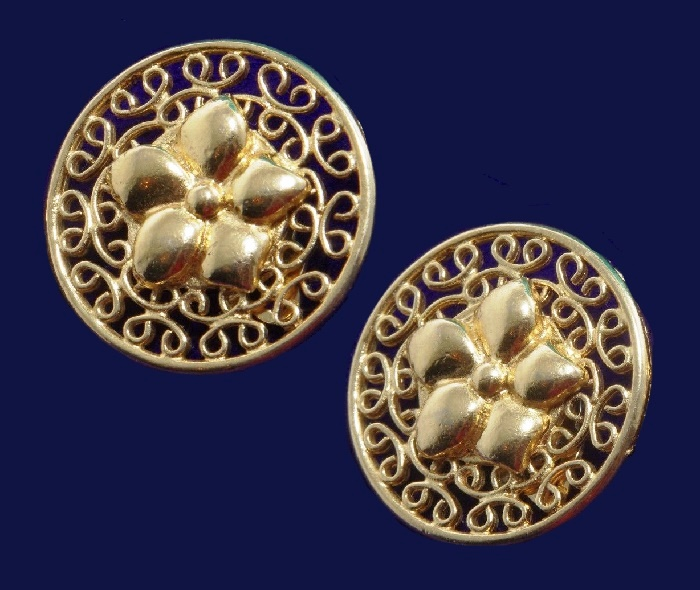 Gold color circle earrings with a flower in center
