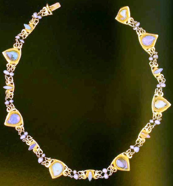 Gold necklace with opals and small pearls. In the design - Celtic motifs, manifested in British art nouveau decorations