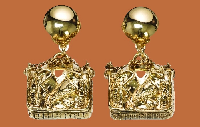 Gold tone earrings. Moschino Couture