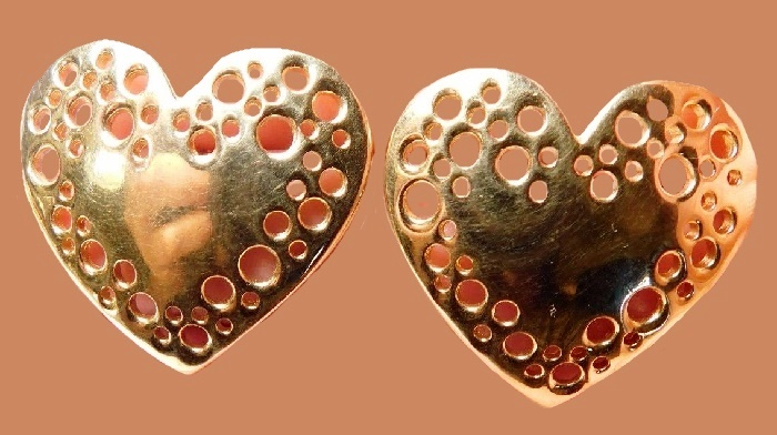 Heart shaped gold tone metal earrings