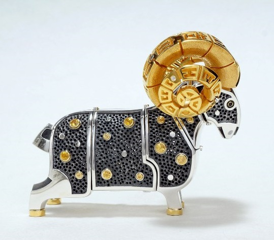 Interior decoration - sculpture 'Aries'. Material - silver, gilding, sapphires. 7x6 cm. Movable head parts