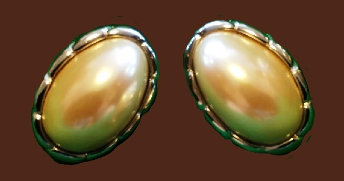 Oval shape earrings, made of jewelery alloy of silver tone, large baroque artificial pearl