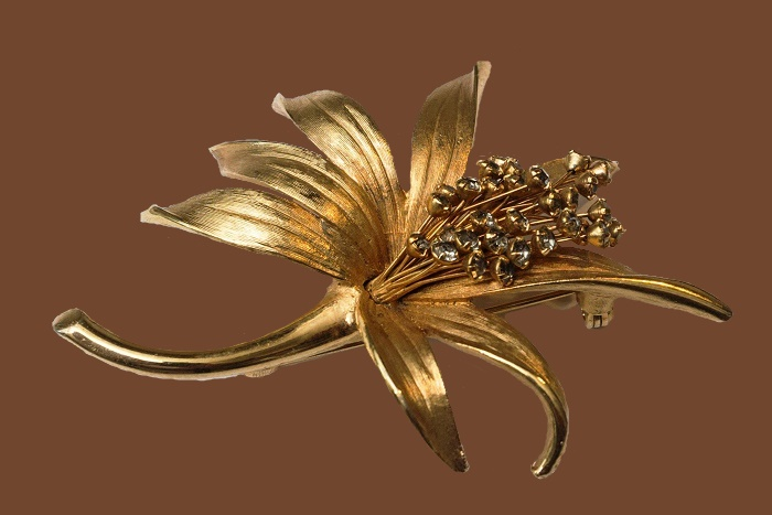 Lily Goldtone and Rhinestone Brooch. 1960s