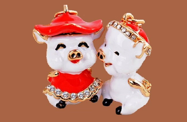 Lovely couple of pigs. Crystal, enamel