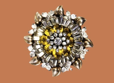 Marked Pennino Sterling. Gold-plated sterling brooch with white baguettes, citrine stones and rhinestones, depicting a beaming Diameter 4.5cm