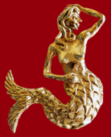 Mermaid gold tone brooch. 1980s