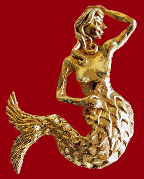 Mermaid gold tone brooch. 1980s