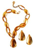 Necklace with pendant and earrings. Lucite of golden tone, metal, gilding. The end of the 1990s. Circumference 51 cm, length of earrings 5 cm £ 150-200
