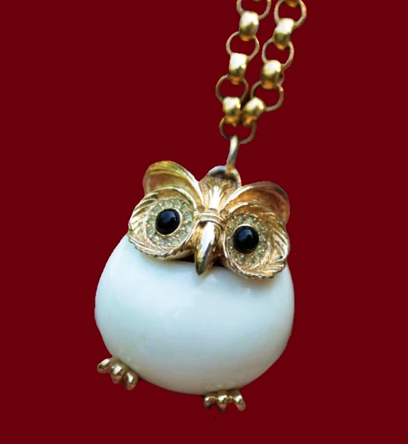 Owl suspension. Black eyes-cabochons surrounded with pale yellow crystals. The body of the owl - white lucite, similar to bakelite. 3.5 x 3 cm