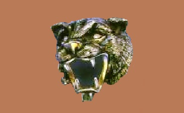 Panther head brooch in gold with enamel and diamonds. 1960. Italy