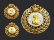 Queen brooch and clips. In the center a bas-relief of a lady in a diadem, on the top a three-dimensional crown, a laurel wreath - a symbol of glory and grandeur. 1940s