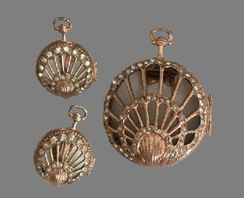 Set in heraldic style, sterling silver, gilding. 1940's. Brooch and clips - in the form of watches, decorated with artificial pearls, vintage rhinestones, the color of pink gold