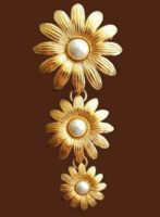 Three golden flowers brooch, made of jewelry alloy and faux pearls. 1970s