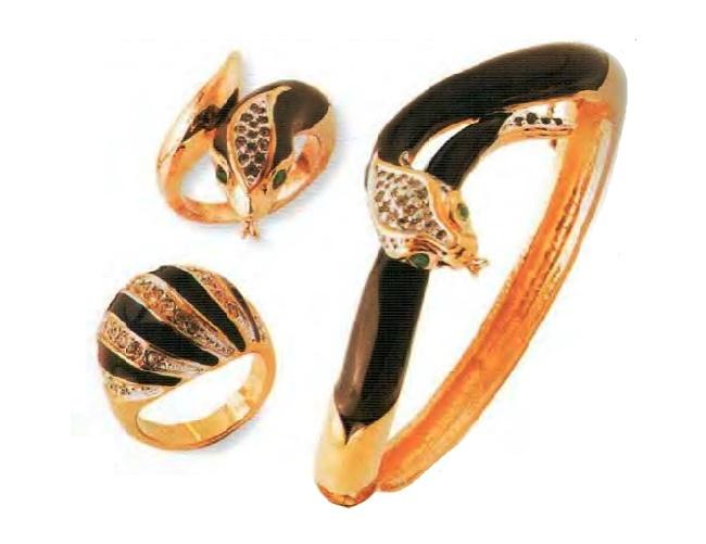 Two rings and a bracelet. Metal, gilding, black enamel, black rhinestone. 1960s. £ 185-215 MG