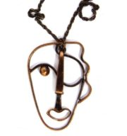 Abstract style face, copper pendant. 1942