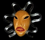 African mask brooch. Wood carving, handpainted, lucite. 1940s