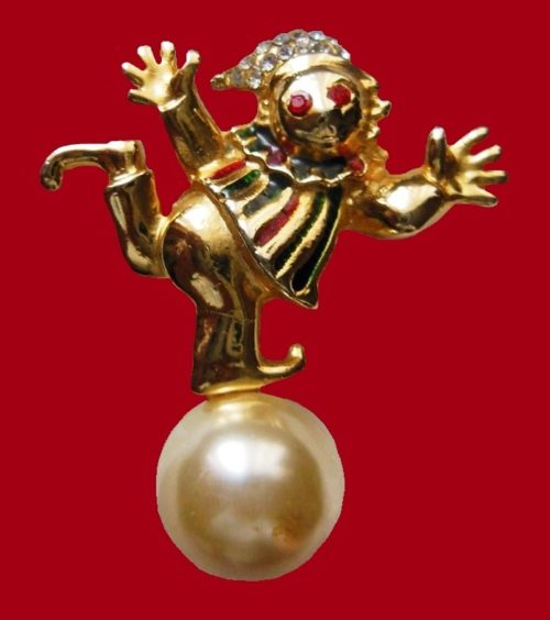 Beautiful original brooch in the form of a clown balancing on a large ball. 1980s. Jewelry alloy of gold color, decorated with crystals of glass. The ball - covered with mother of pearl