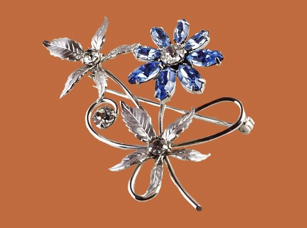 Blue crystal silver tone brooch. 1960s