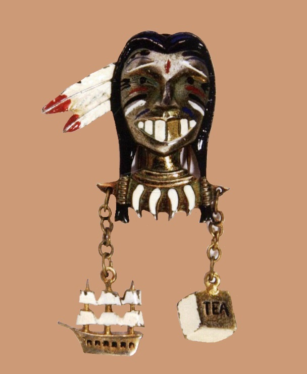 Boston tea party, 1940. Designer Victor Silson. Gold-plated metal pin clip, with black, white and red enamel, depicting the head of a staring Mohawk redskin, 7.8x4.3cm