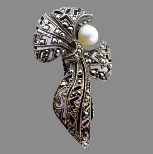 Bow Dress clip. marcasites, sterling silver, daux pearl. 1930s