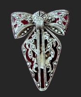 Bow fur clip. Silver and marcacite. 1930s