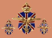 British and American Ambulance Corps, 1940. Designer Victor Silson. Gold-plated pin clip and earrings, white, blue and red enamel