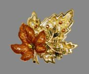 Brown leaves. Pearly enamel of orange, ocher and green colors, brown and green rhinestones. 6 cm