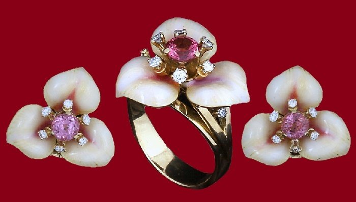 Buttercup flower The delicate color of the enamel is set off by a thick pink sapphire surrounded by diamond stamens. Materials - diamond, sapphire, gold, silver, enamel