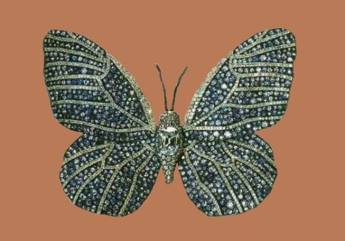 Butterfly brooch. 1987. Wings covered with sapphires and diamonds, the body in the center - decorated with a large oval diamond