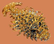 Chinese dragon brooch. Gold plated, rhinestones