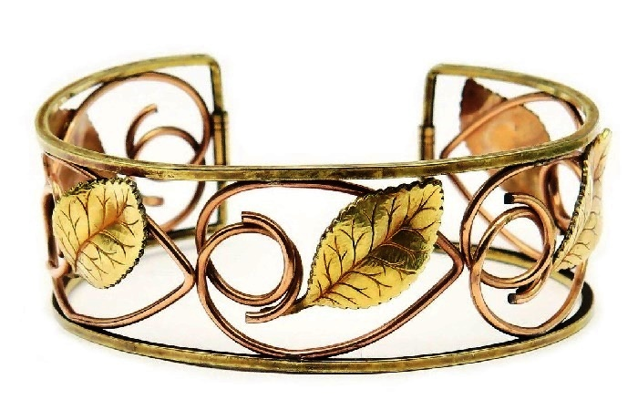 Cuff bracelet 'Flora'. jeweler's alloy, a covering - gilding 14 carat of two shades (pink and yellow gold). 1950s. width 2.3 cm