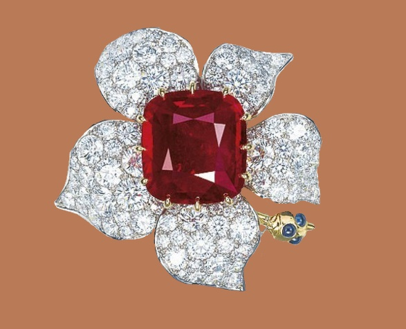 Flower brooch with a ruby stone in the center. Diamonds, platinum