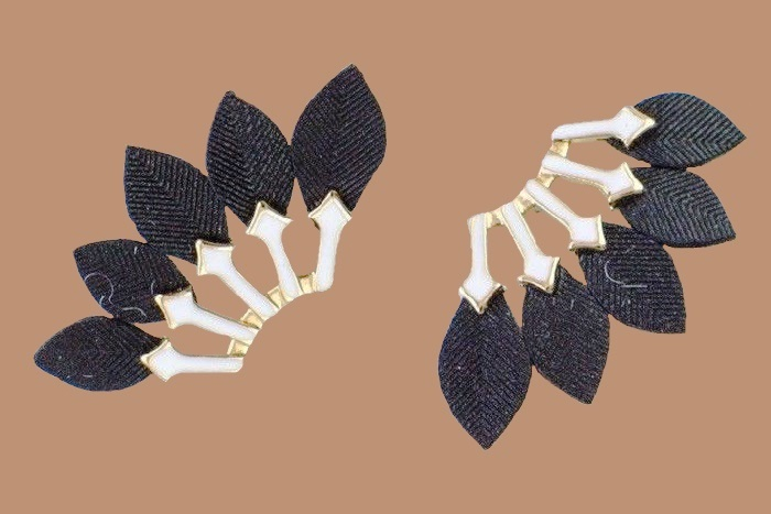 Genuine leather feathers fan out from under a white enamel geometric setting