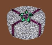 Gift brooch. Platinum, diamonds and garnet