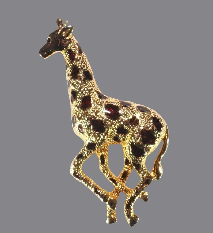 Giraffe brooch of gold tone and black enamel spots