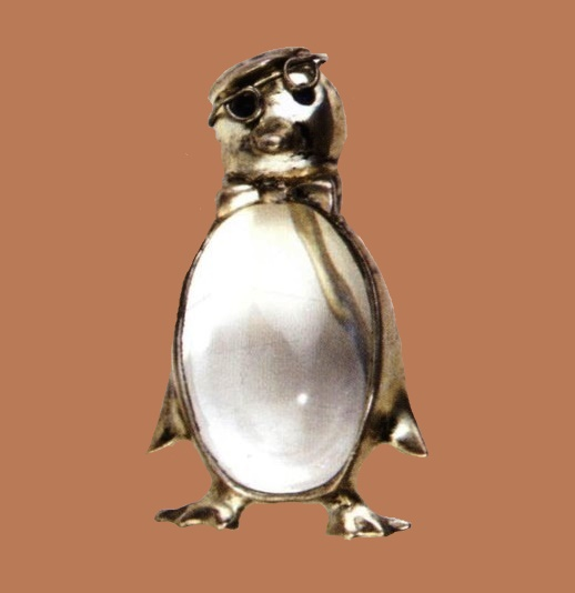 Gold-plated sterling brooch,1945. Lucite and blue rhinestones eyes, depicting a penguin wearing a beret, bow tie and spectacles. 5.5x3.5cm. Marked Sterling