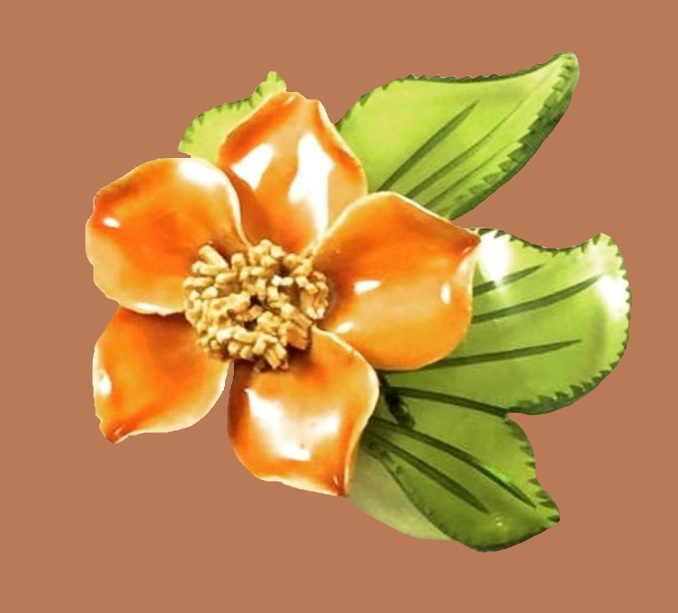 Green and orange ceramic and lucite flower brooch. 1940s